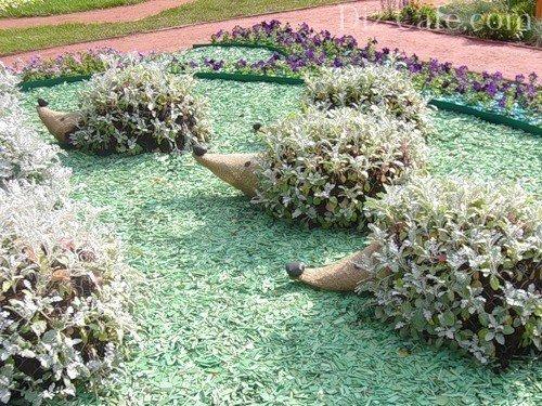 Цветок органзКак сделать вертикальную клумбу своими руками