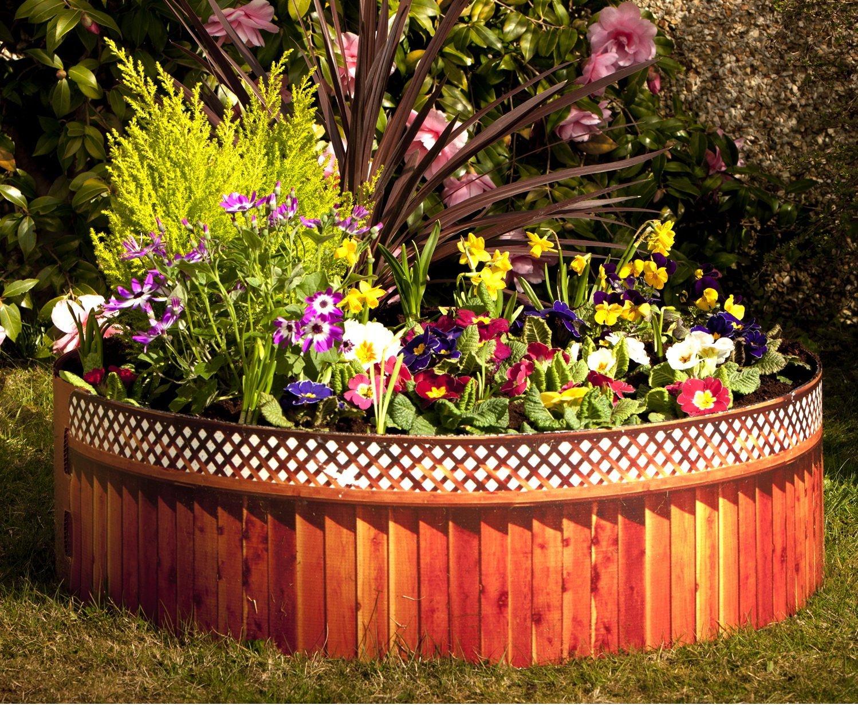 Оформление клумб в саду своими руками фото 100