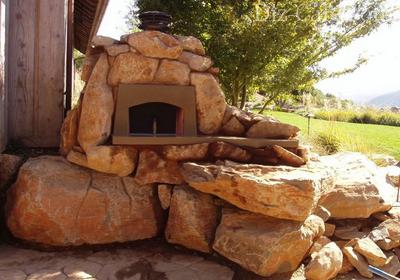 Каменный камин в саду