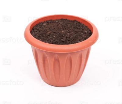 Горшок, наполненный грунтом